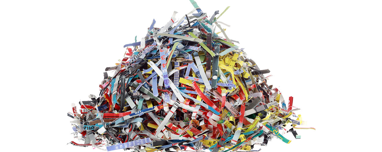 Pile Of Colorful Shredded Paper On A White Background For Shred Event